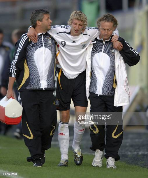 Germany's Stefan Kiessling is helped off after being injured during the Men's Under 21 UEFA Qualifier between Northern Ireland and Germany at the...
