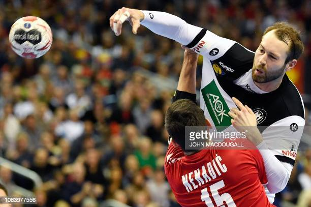 Germany's Steffen Faeth shoots past Serbia's Drasko Nenadic during the IHF Men's World Championship 2019 Group A handball match between Germany and...
