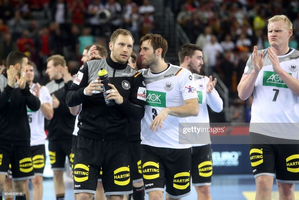 Germany's Steffen Weinhold (L), Uwe Gensheimer (C) and Patrick Wiencek (R) celebrate their victory at the end of the preliminary round group C match of the Men's 2018 EHF European Handball Championship between Germany and Montenegro in Zagreb on January 13, 2018. /