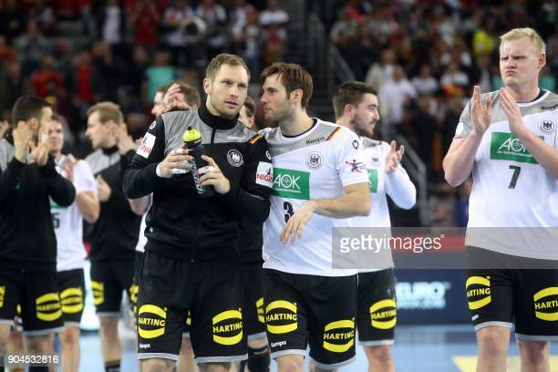 Germany's Steffen Weinhold Uwe Gensheimer and Patrick Wiencek celebrate their victory at the end of the preliminary round group C match of the Men's...