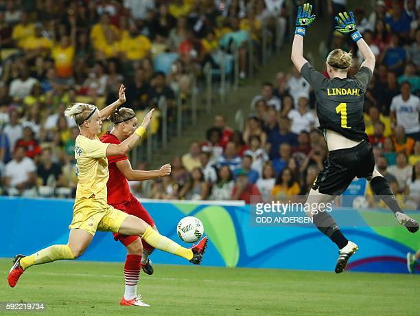 Germany's striker Alexandra Popp Sweden's goalkeeper Hedvig Lindahl and Sweden's defender Nilla Fischer vie for the ball during the Rio 2016 Olympic...