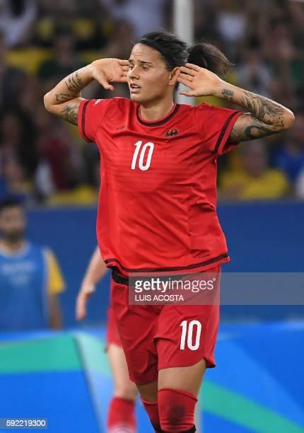 Germany's striker Dzsenifer Marozsan celebrates her team's second goal after Sweden's defender Linda Sembrant scored an own goal during the Rio 2016...