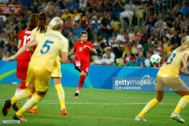 Germany's striker Dzsenifer Marozsan takes a free kick during the Rio 2016 Olympic Games women's football Gold medal final match at the Maracana...