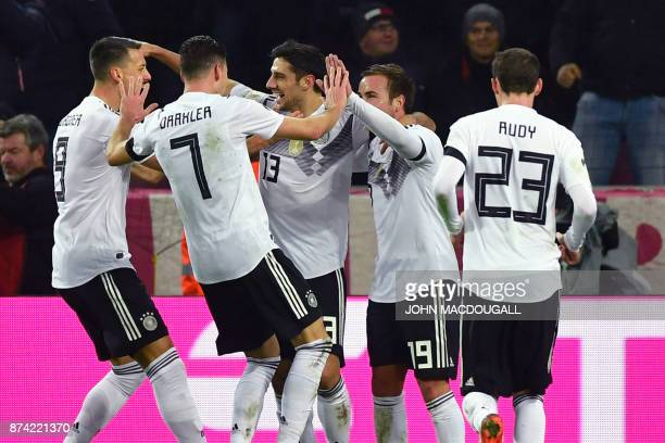 Germany's striker Lars Stindl celebrates scoring the 22 with his teammates during the international friendly football match Germany against France in...