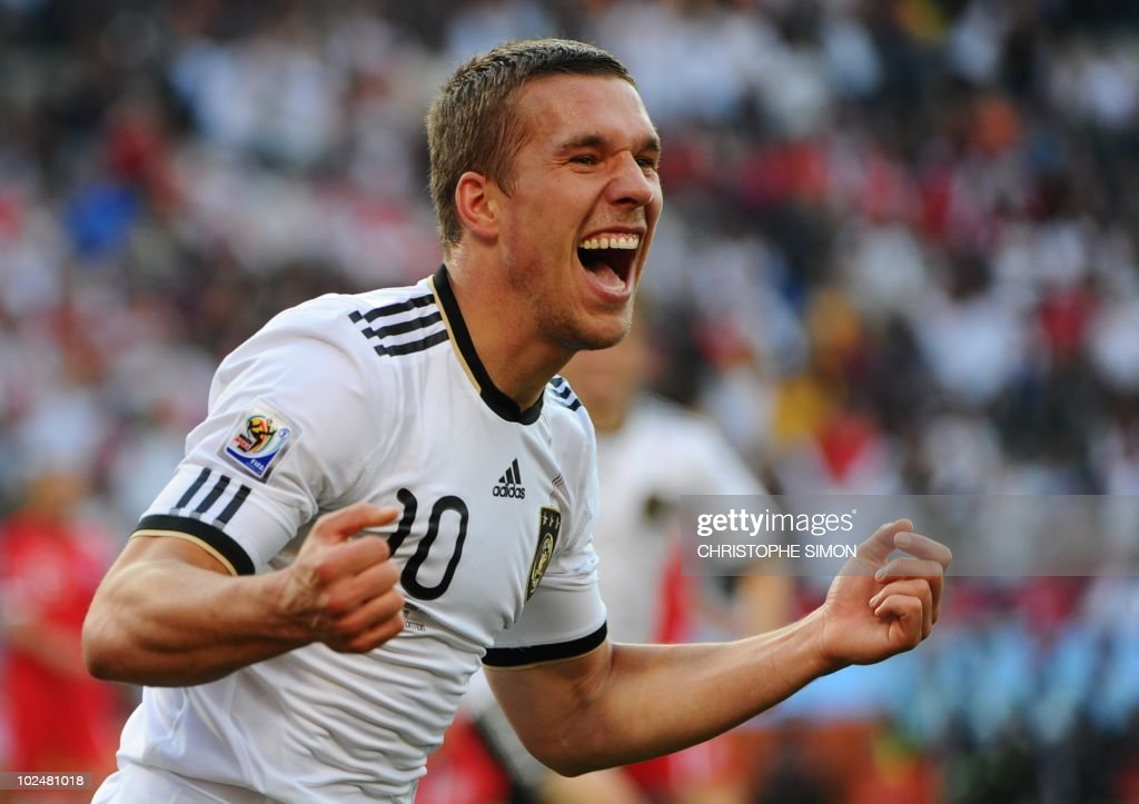 Germany's striker Lukas Podolski (10) celebrates with teammates after scoring a second goal during the 2010 World Cup round of 16 match Germany vs England on June 27, 2010 at Free State stadium in Mangaung/Bloemfontein. NO