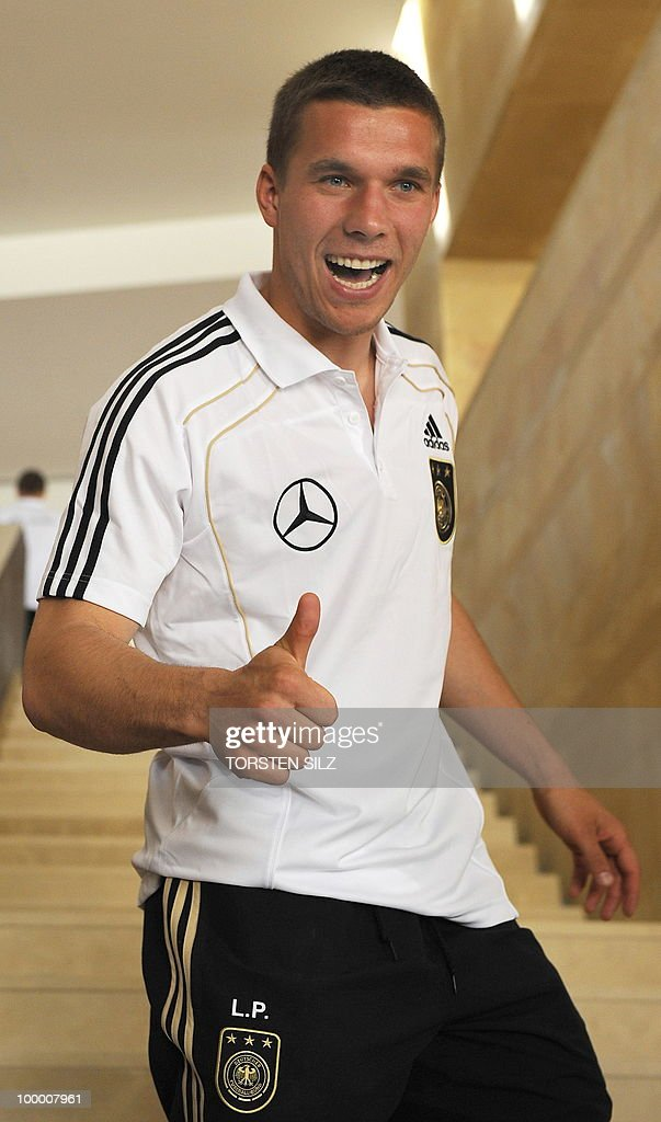 Germany's striker Lukas Podolski gives the thumbs up sign during a so-called media day at the Verdura Golf and Spa resort, near Sciacca May 19, 2010. The German team is currently taking part in a 'Regeneration' camp in Sicily to prepare for the upcoming FIFA Football World Cup in South Africa.