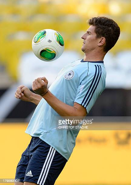 Germany's striker Mario Gomez controls the ball during the final training's session of the German national football team in the arena in Munich...