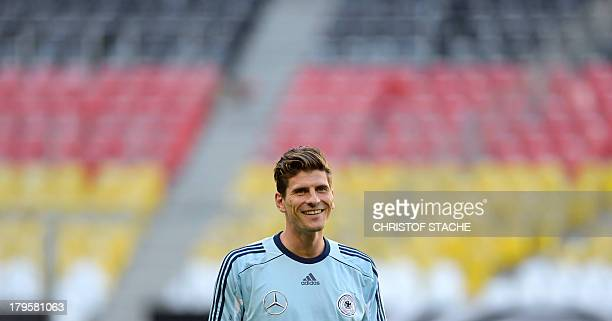 Germany's striker Mario Gomez smiles during the final training's session of the German national football team in the arena in Munich southern Germany...