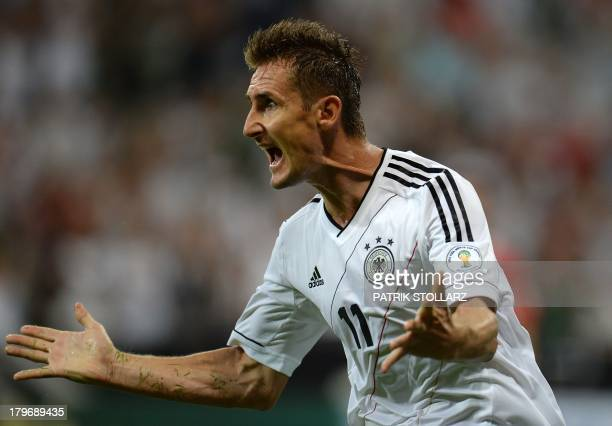Germany's striker Miroslav Klose celebrates after scoring the 10 during the FIFA World Cup 2014 group C qualifying football match of Germany vs...