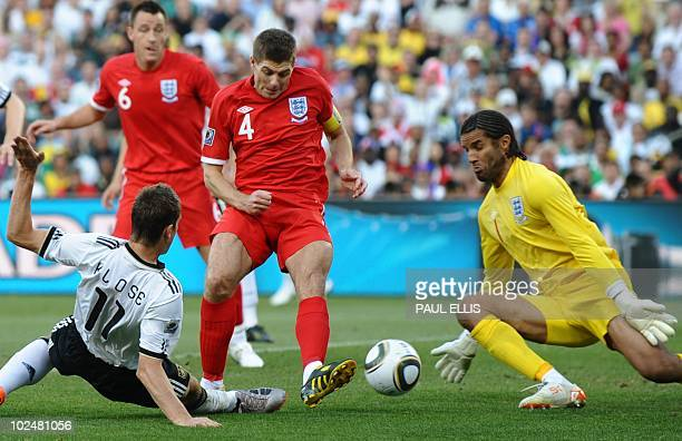 Germany's striker Miroslav Klose fights for the ball with England's midfielder Steven Gerrard and England's goalkeeper David James during the 2010...