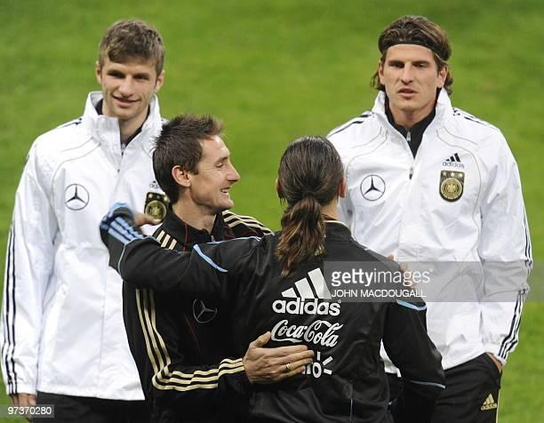 Germany's striker Miroslav Klose greets Argentina's defender Martín Demichelis as Germany's striker Mario Gomez and Germany's Thomas Mueller look on...