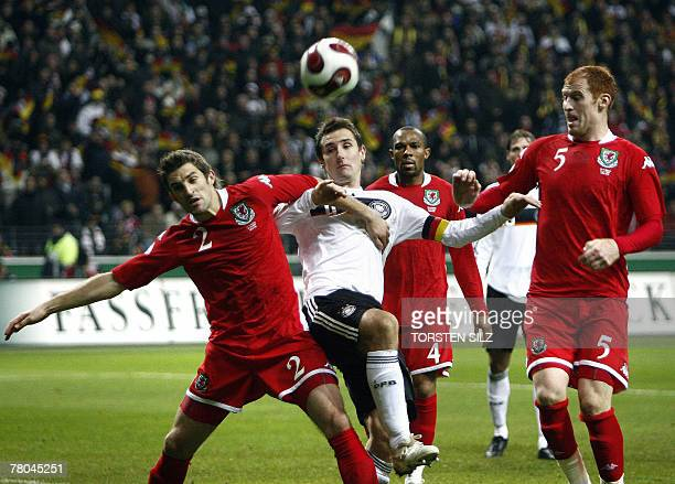 Germany's striker Miroslav Klose vies with Wales' Samuel Derek Ricketts and defender James Michael Collins during their group D Euro 2008 qualifier...
