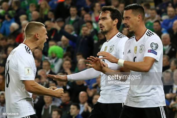 Germany's striker Sandro Wagner celebrates with Germany's defender Joshua Kimmich and Germany's defender Mats Hummels after scoring their second goal...