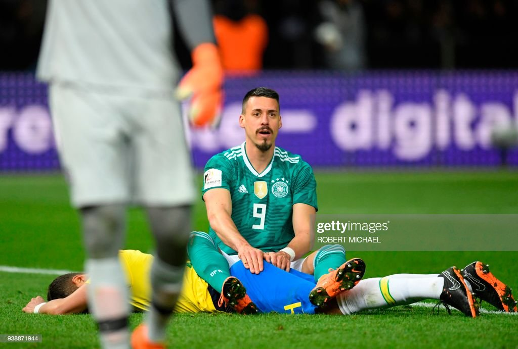Germany's striker Sandro Wagner (top) reacts with Brazil's defender Thiago Silva during the international friendly football match between Germany and Brazil in Berlin, on March 27, 2018. /
