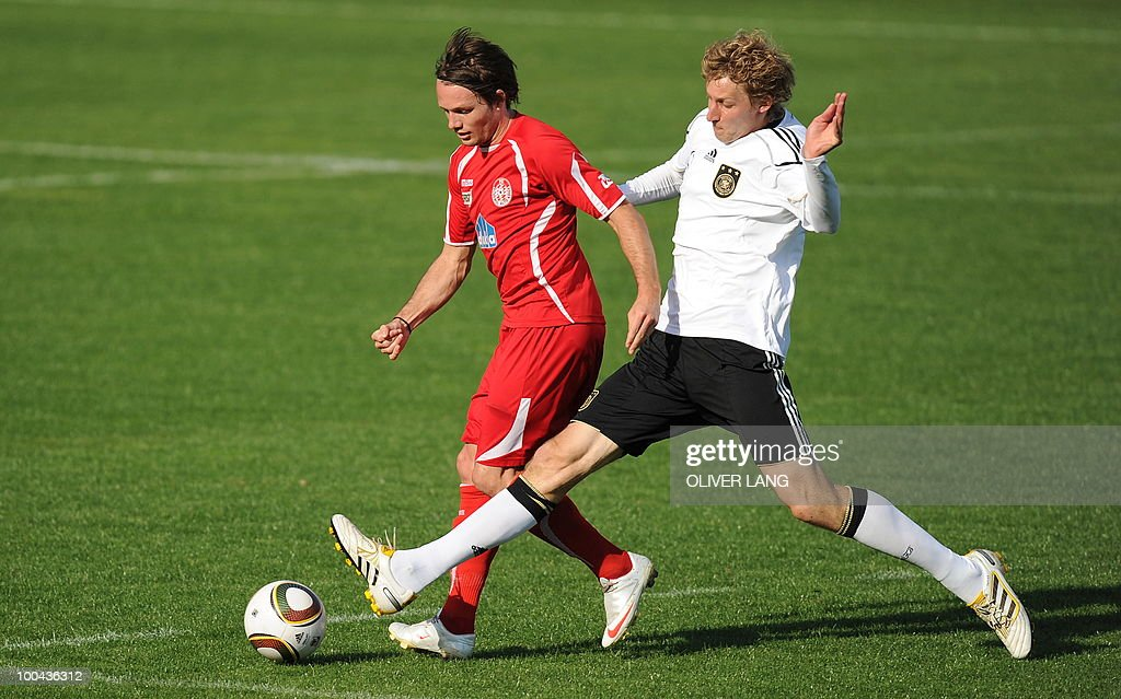 Germany's striker Stefan Kiessling (R) vies with Suedtirol's Michael Bacher during a training match Germany vs Sued Tyrol FC at the team's training centre in Appiano, near the north Italian city of Bolzano May 24, 2010. The German football team is currently taking part in a 12-day training camp in Appiano to prepare for the upcoming FIFA Football World Cup in South Africa.