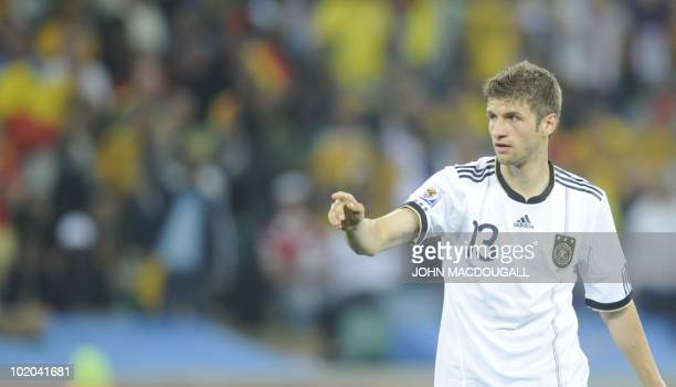 Germany's striker Thomas Mueller celebrates after scoring Germany's third goal during the Group D first round 2010 World Cup football match Germany...