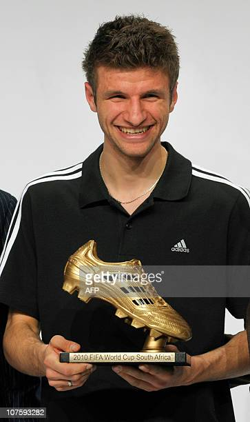 Germany's striker Thomas Mueller Golden Boot winner poses with his award during the FIFA Soccer World Cup 2010 award ceremony at the headquarters of...