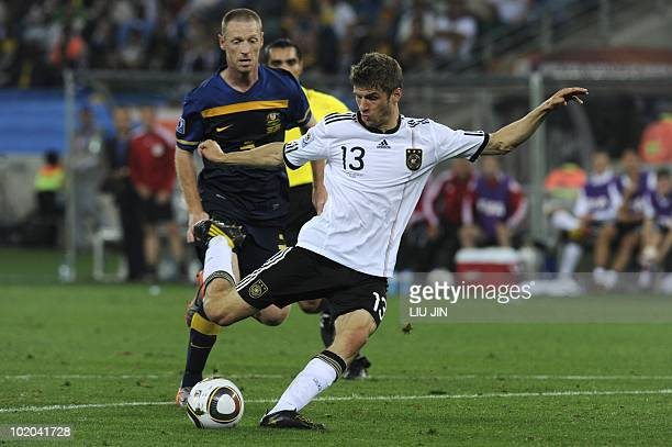 Germany's striker Thomas Mueller prepares to kick the ball to score Germany's third goal against Australia during their Group D first round 2010...