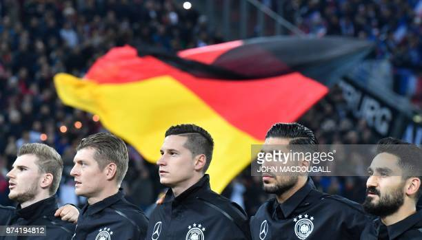 Germany's striker Timo Werner Germany's midfielder Toni Kroos Germany's midfielder Julian Draxler Germany's midfielder Emre Can and Germany's...