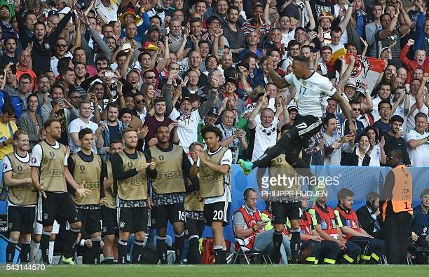 Germany's supporters celebrate after defender Jerome Boateng scored during the Euro 2016 round of 16 football match between Germany and Slovakia at...