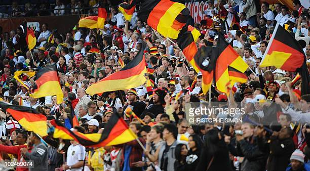 Germany's supporters react after midfielder Thomas Mueller scored Germany's 3rd goal during the 2010 World Cup round of 16 football match England...