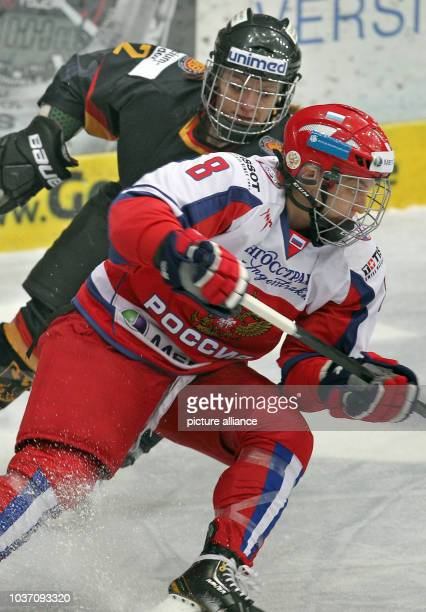 Germany's Susann Goetz in action against Russia's Iya Gavrilova during the women's Nations Cup 2014 ice hockey match between Germany and Russia in...