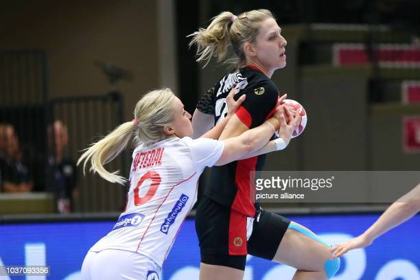 Germany's Susann Mueller and Norway's Stine Oftedal vie for the ball during the World Women's Handball Championship match between Germany and Norway...