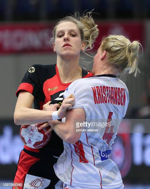 Germany's Susann Mueller and Norway's Veronika Kristiansen vie for the ball during the World Women's HandballChampionship match between Germany and...