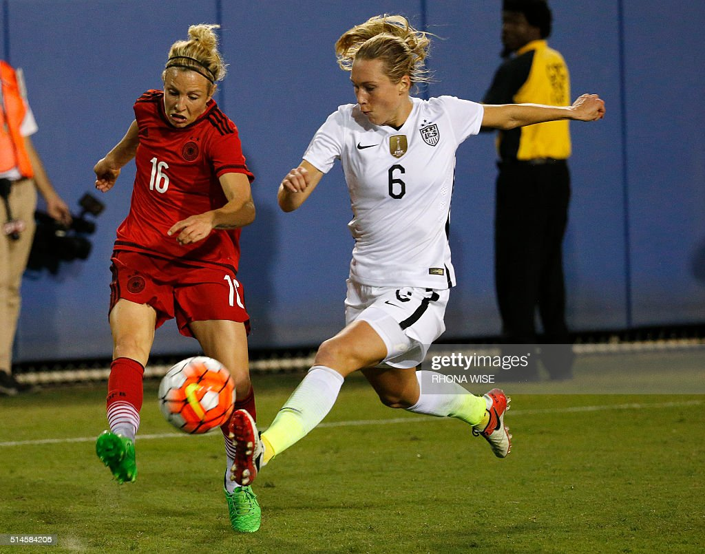 Germany's Svenja Huth (L) and USA's Whitney Engen (R) vie for the ball during their SheBelieves Cup soccer match March 9, 2016 in Boca Raton, Florida. / AFP / RHONA