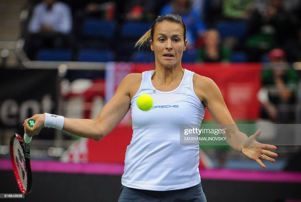 Germany's Tatjana Maria hits a return to Belarus' Vera Lapko during their tennis single match as part of the Federation Cup world group first round tennis tie between Belarus and Germany in Minsk on February 11, 2018. /