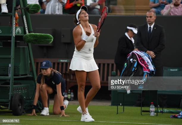 Germany's Tatjana Maria reacts after winning against Ukraine's Elina Svitolina during their women's singles first round match on the first day of the...