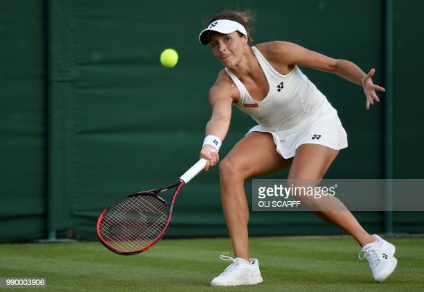 Germany's Tatjana Maria returns against Ukraine's Elina Svitolina during their women's singles first round match on the first day of the 2018...