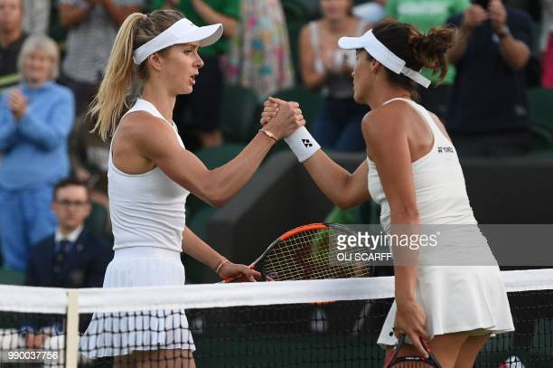 Germany's Tatjana Maria shakes hands after winning against Ukraine's Elina Svitolina during their women's singles first round match on the first day...
