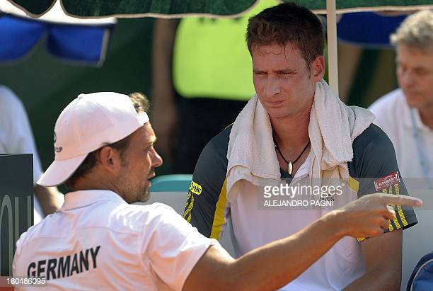 Germany's team captain Carsten Arriens gives instructions to player Florian Mayer during the 2013 Davis Cup World Group first round single tennis...