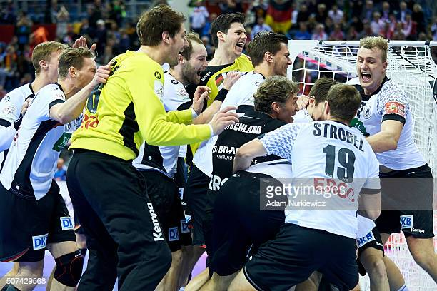 Germany's team celebrate after victory during the Men's EHF Handball European Championship 2016 semifinal match between Germany and Norway at Tauron...