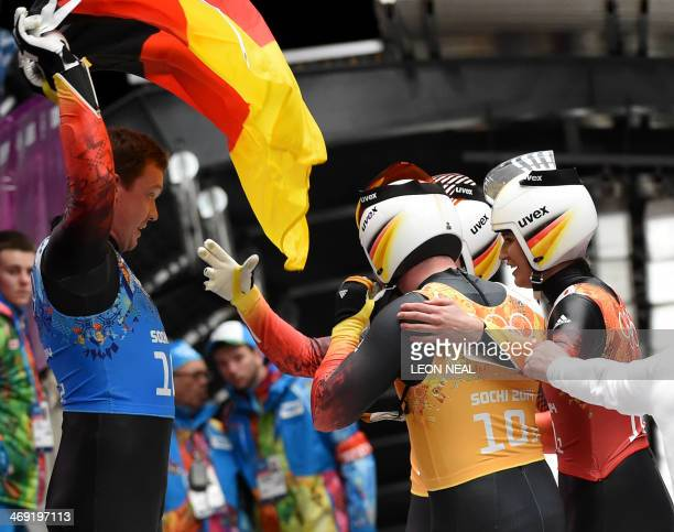 Germany's team celebrate their Gold Medal at the Sliding Center Sanki during the Sochi Winter Olympics on February 13 2014 AFP PHOTO / LEON NEAL