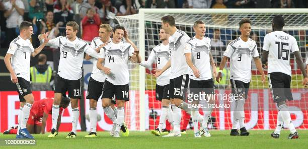 Germany's team celebrates scoring the 21 during the international friendly football match Germany vs Peru at the RheinNeckarArena in Sinsheim...