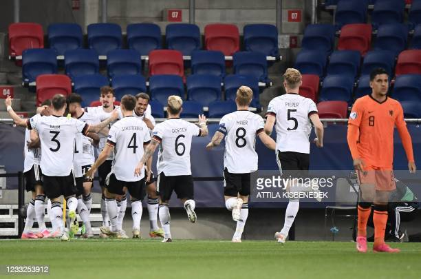 Germany's team celebrates the 0-1 during the UEFA Under21 Championship semi final football match between the Netherlands and Germany in...