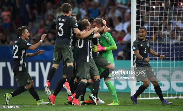 Germany's team celebrates victory after Germany's goalkeeper Julian Pollersbeck saved the last penalty in penalty shooting during the UEFA U21...