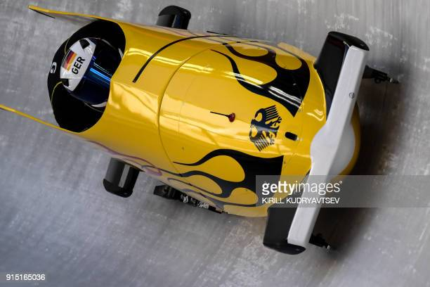 Germany's team leader and driver Anna Koehler takes a turn in the first women's unofficial bobsleigh training session at the Olympic Sliding Centre...