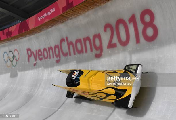 Germany's team leader and driver Stephanie Schneider takes a turn in the first women's unofficial bobsleigh training session at the Olympic Sliding...