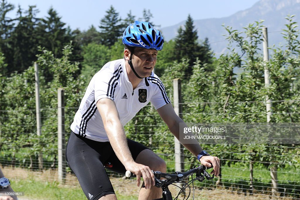 Germany's team manager Oliver Bierhoff sits on a mountain bike at the training camp of the German team in Appiano, near the north Italian city of Bolzano, on May 25, 2010. The German football team is currently taking part in a 12-day training camp to prepare for the upcoming FIFA Football World Cup in South Africa.
