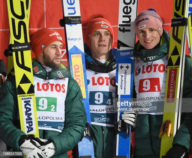 Germany's team Markus Eisenbichler Stephan Leyhe Karl Geiger pose on the podium after the men's team event at the FIS Ski Jumping World Cup...