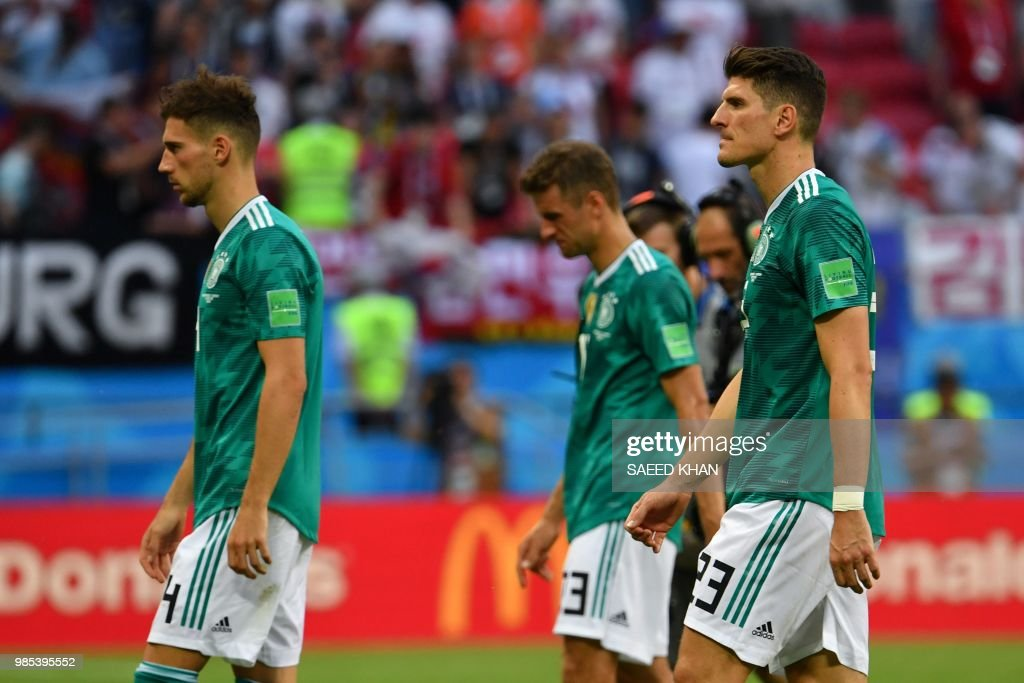 TOPSHOT - Germany's team players react at the end of the Russia 2018 World Cup Group F football match between South Korea and Germany at the Kazan Arena in Kazan on June 27, 2018. (Photo by SAEED KHAN / AFP) / RESTRICTED