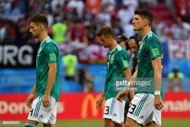 TOPSHOT Germany's team players react at the end of the Russia 2018 World Cup Group F football match between South Korea and Germany at the Kazan...