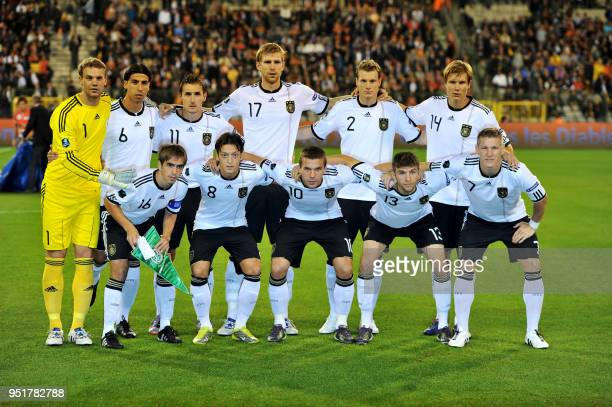 Germany's team poses for a family portrait at the beginning of the first qualfication match for the Euro 2012 soccer championship between Belgium and...