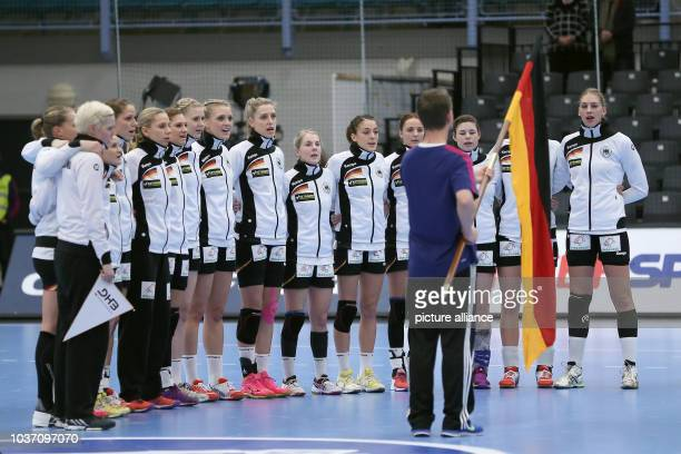 Germany's team sings the national anthem at a handball match between Germany and the DR Congo at the IHF Women's Handball World Championship in...
