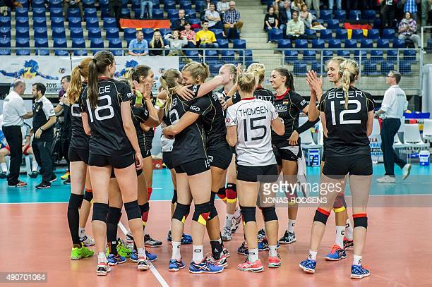 Germany's teammmates celebrate after defeating Hungary during the womens European Volleyball Championship between Germany and Hungary in Antwerpen on...