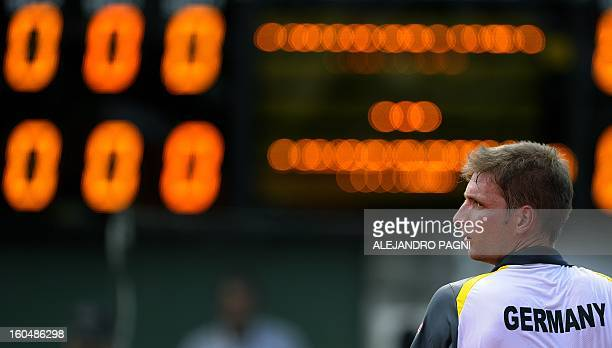 Germany's tennis player Florian Mayer gestures during the 2013 Davis Cup World Group first round single tennis match against Argentina's Juan Monaco...