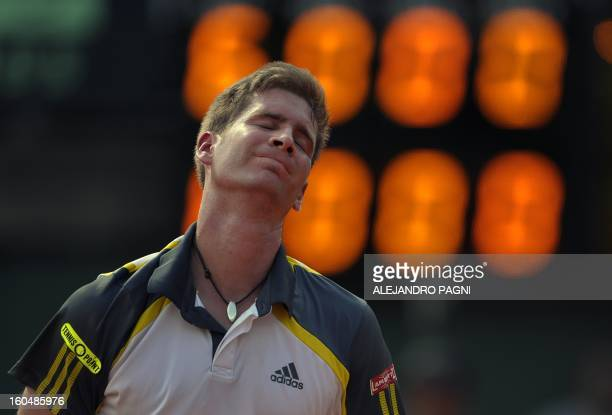 Germany's tennis player Florian Mayer reacts after missing a point against Argentina's Juan Monaco during the 2013 Davis Cup World Group first round...